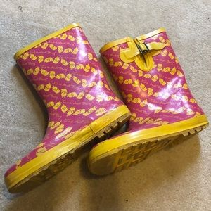 Yellow duck and pink rainboots